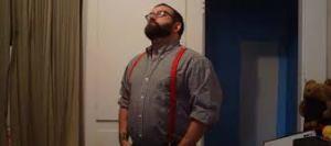 large guy in suspenders